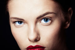 Portrait of a beautiful sexy brunette girl. With red lips Royalty Free Stock Image