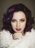 Portrait of beautiful fashion model with purple hair over g stock photo