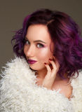 Portrait of beautiful fashion model with purple hair over g royalty free stock photos
