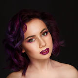 Portrait of beautiful fashion model with purple hair over g royalty free stock photography