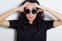 Portrait of beautiful fashion model in round sunglasses. Portrait of beautiful fashion model stock photo