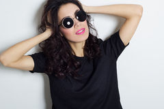 Portrait of beautiful fashion model in round sunglasses. Portrait of beautiful fashion model stock image