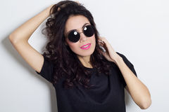 Portrait of beautiful fashion model in round sunglasses. Portrait of beautiful fashion model stock photography