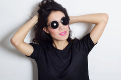 Portrait of beautiful fashion model in round sunglasses. Portrait of beautiful fashion model royalty free stock image