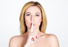 Portrait of beautiful sexy fashion model saying shh Royalty Free Stock Images