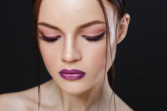 Portrait of beautiful sexy girl with bright makeup close-up. Young face with a luxury make up close-up Stock Images