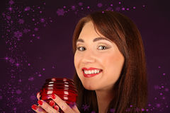 Portrait of beautiful sexy girl, holding candle, wearing santa claus clothes Royalty Free Stock Image
