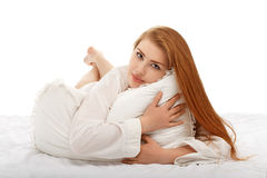Portrait of a beautiful girl lying in bed in a man's shirt stock photos