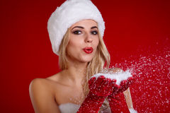 Portrait of beautiful sexy girl wearing santa claus clothes Stock Photos