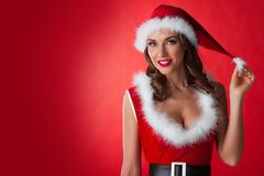 Girl wearing santa claus clothes Stock Images