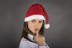 Portrait of beautiful sexy girl wearing santa claus clothes and Royalty Free Stock Images