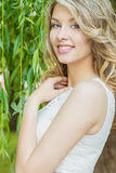 Portrait of beautiful happy smiling girl with big full lips, with white hair in a white dress stock photo