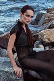 Portrait beautiful perfect woman model brunette fashion. Style clothes wear black silk dress collection natural beauty cosmetic makeup storm weather ocean water royalty free stock images