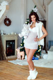 Portrait of beautiful sexy pregnant brunette in white transparen Royalty Free Stock Photos