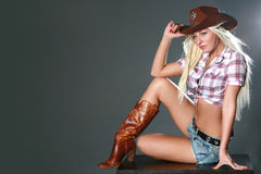 Portrait of a beautiful sexy rodeo girl Royalty Free Stock Photo