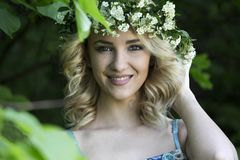 Beautiful sexy smiling girl with a wreath on his head in the spring park Stock Photo