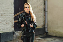 Portrait of a beautiful sexy woman. In black leather jacket Stock Images