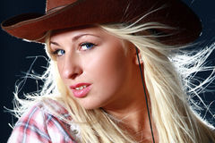 Portrait of a beautiful sexy woman in cowboy hat. Close-up portrait of a beautiful sexy woman in cowboy hat Royalty Free Stock Photos