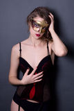 Portrait of beautiful sexy woman in lingerie and mask posing ove Royalty Free Stock Photo