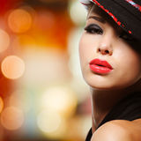 Portrait of the beautiful woman with red lips. In modern black hat royalty free stock photography