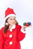 Portrait of beautiful sexy woman wearing santa claus hat  holdin Stock Photo
