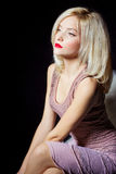 Portrait of a beautiful sexy women blonde with red lipstick and arrow keys on the eyes in a pink dress in the Studio Royalty Free Stock Images