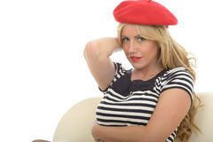 Portrait Of A Beautiful Sexy Young French Woman Wearing A Red Beret and Fish Net Stockings Stock Photography
