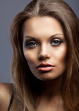 Portrait of beautiful and young serious woman Stock Images