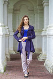 Portrait of a beautiful sexy young woman in dark blue coat Royalty Free Stock Images