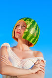 Portrait of beautiful young woman model with water-melon on head Royalty Free Stock Images