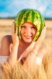 Portrait of beautiful sexy young woman model with water-melon on head Stock Photography