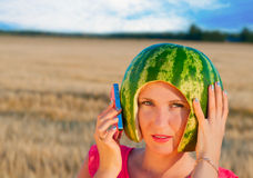 Portrait of beautiful young woman model with water-melon on head Royalty Free Stock Image