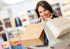 Portrait of shopaholic woman smiling Royalty Free Stock Images