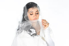 Portrait of beautiful shy bride with veil Royalty Free Stock Photos