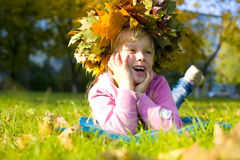 Portrait of the beautiful six-year-old girl in a wreath from aut Royalty Free Stock Image