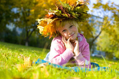 Portrait of the beautiful six-year-old girl in a wreath from aut Stock Images