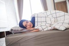 Sleeping muslim woman in bed Stock Photo