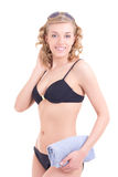 Portrait of beautiful slim woman in bikini with towel over white Stock Photo