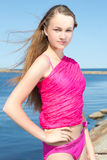 Portrait of beautiful slim woman in pink at the beach Stock Photo