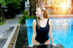 Portrait of beautiful slim woman in swimming pool sunny day. Sunshine portrait of beautiful slim woman in swimming pool. concepr of aqua exercises, travel nature Stock Photography
