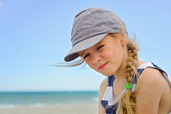 Portrait of beautiful small girl in denim hat Stock Images