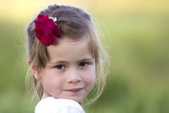 Portrait of beautiful small preschool blond girl with nice gray stock photography