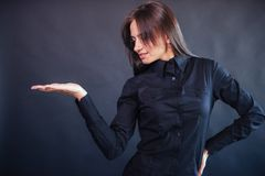 Portrait of beautiful smart young businesswoman in business attire. On a dark background Stock Photography