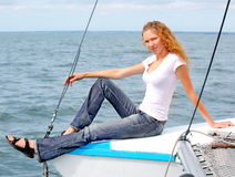 Portrait of a beautiful smile young woman  on the yacht Stock Images