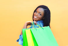 Portrait beautiful smiling african woman with shopping bags Royalty Free Stock Photo