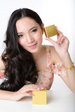 Portrait of beautiful smiling asian woman model is holding cosme Royalty Free Stock Image