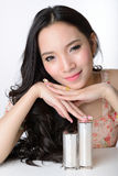 Portrait of beautiful smiling asian woman model is touching cosm Royalty Free Stock Photos
