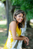 Portrait of a beautiful smiling biracial woman. Beautiful young biracial woman - outdoor portrait wearing a yellow blouse smiling stock images