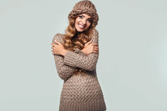 Portrait of beautiful smiling blond woman. With long hair, brown sweater and hat Royalty Free Stock Image