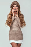 Portrait of beautiful smiling blond woman. With long hair, brown sweater and hat Royalty Free Stock Photo